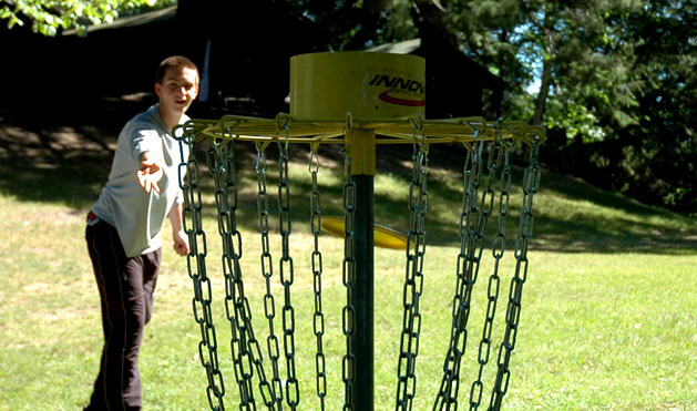 Nine holes of disc golf through camp