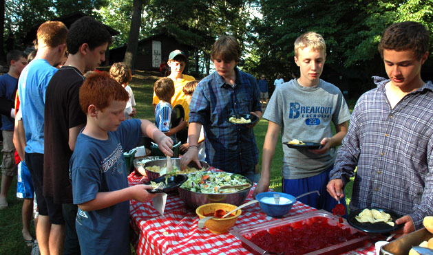 It's a picnic dinner on Junior Hill. Burgers, salad, veggies, chips and jello and ice-cream cones for dessert!