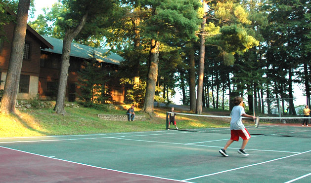 Tennis with dad looking on