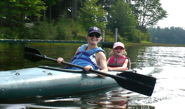 Mom and daughter take a quick kayak around the lake